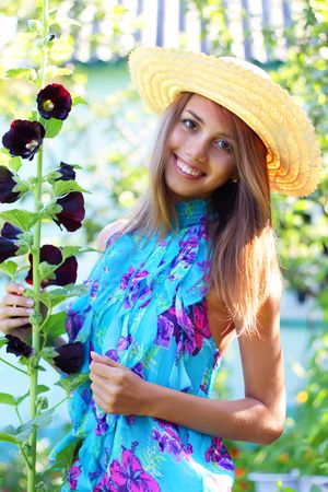 mallow: Beautiful girl next to mallow Stock Photo