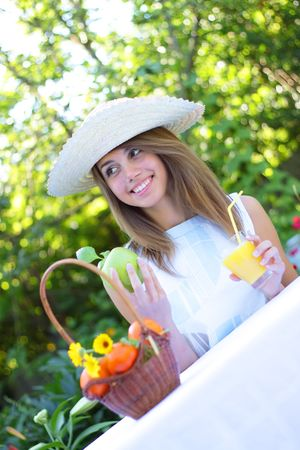 A beautiful girl sitting at the table Stock Photo - 7511456