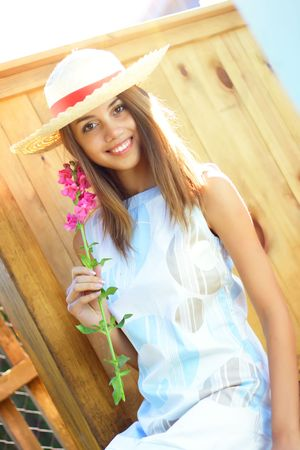 beautiful girl with a flower in her hand Stock Photo - 7511449