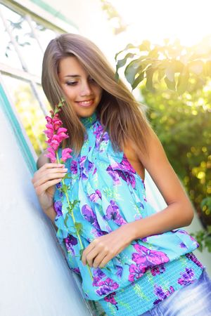 Beautiful girl holding a flower Stock Photo - 7511460