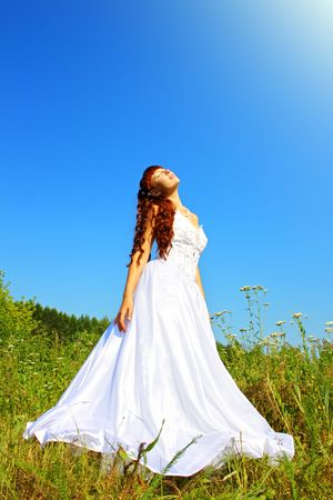 tall grass: Bride in nature against the sky Stock Photo