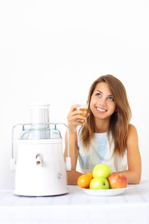 Happy girl about juicer photo
