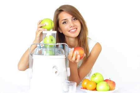 Happy girl about juicer Stock Photo - 7544302