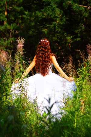 redhead: Girl in white dress in the forest Stock Photo