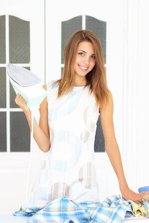 ironing board: Beautiful girl next to ironing board