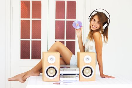 only teens: Beautiful girl listening to music