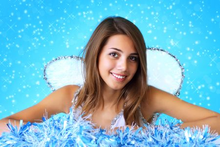 Portrait of a beautiful girl on a blue background photo