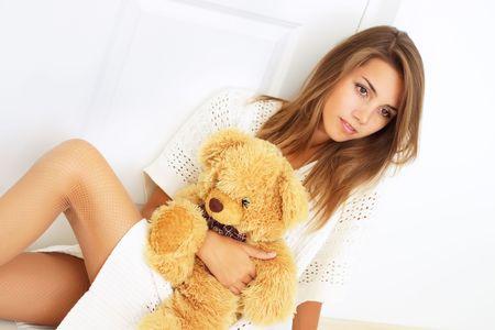 Beautiful girl with a teddy bear photo