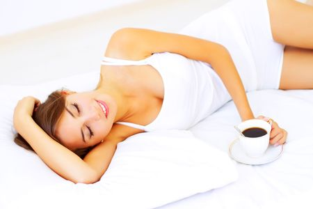 Beautiful girl sleeping on a white bed Stock Photo - 7706751