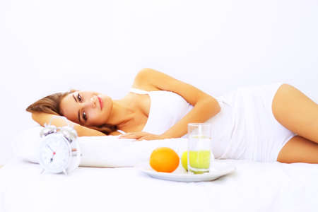Beautiful girl lying on the bed Stock Photo - 7706749