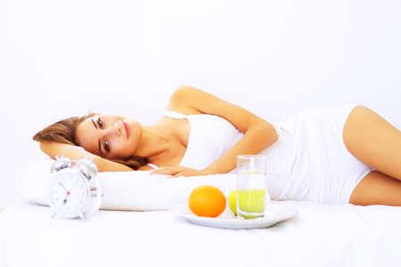 Beautiful girl lying on the bed Stock Photo - 7706749