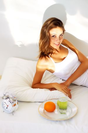 Beautiful girl lying on the bed Stock Photo - 7706772