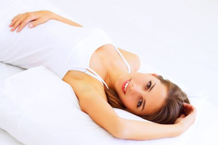 only one girl: Beautiful girl lying on the bed Stock Photo