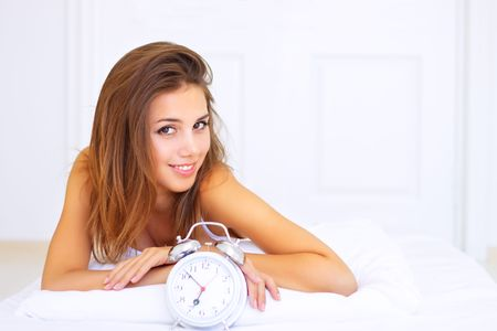 smiling girl lying on the bed Stock Photo - 7706819