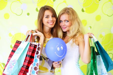 Two attractive girls on a green background Stock Photo - 7706840