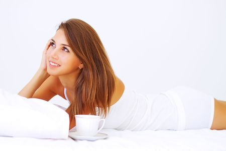 Beautiful girl lying on the bed Stock Photo - 7706824