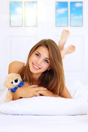 Beautiful girl lying on the bed Stock Photo - 7706820