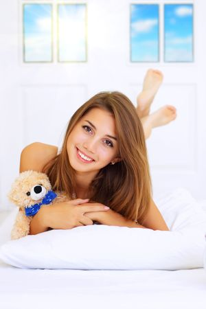 one girl only: Beautiful girl lying on the bed Stock Photo