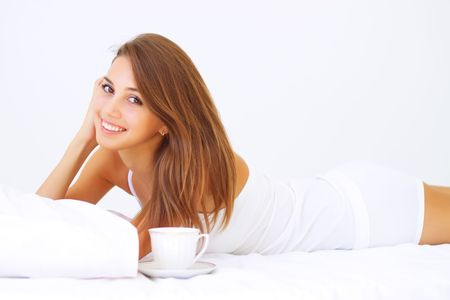 Beautiful girl lying on the bed Stock Photo - 7706855
