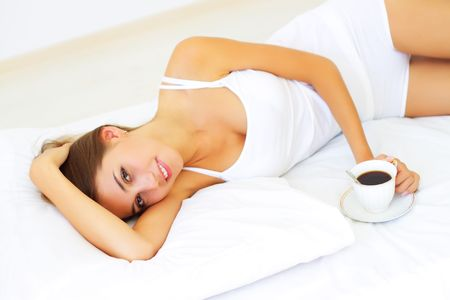 Beautiful girl lying on the bed Stock Photo - 7706845
