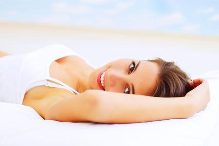 Beautiful girl lying on the bed photo