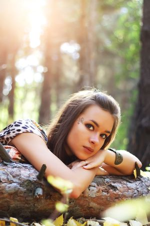 Attractive girl on a background of trees photo