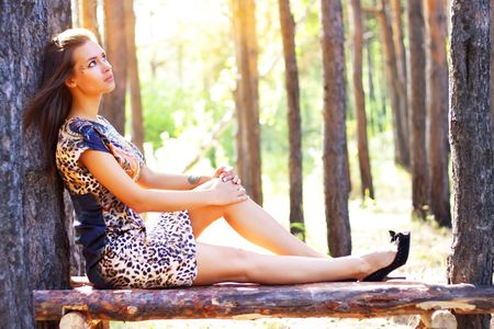 An attractive girl on the nature photo