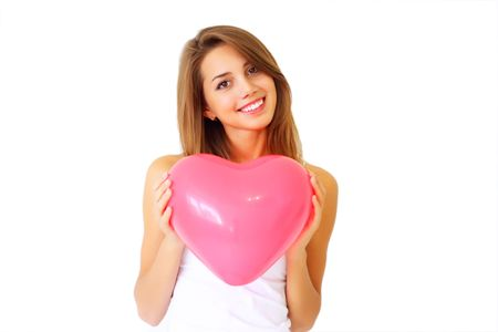smiling girl holding a large decorative heart Stock Photo