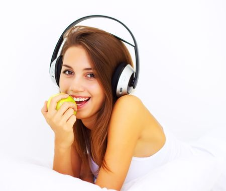 smiling girl listens to music with headphones photo