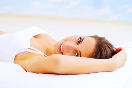 Beautiful girl lying on the bed Stock Photo - 7823966