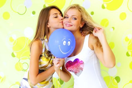 beautiful lesbian: Two attractive girls with a balloon