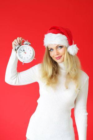 Santa girl on a red background photo