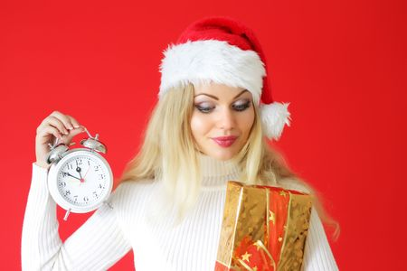 Attractive girl holding an alarm clock with box photo