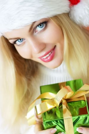 mrs santa claus: Attractive girl holding a gift Stock Photo