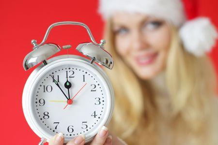 girl holding an alarm clock photo
