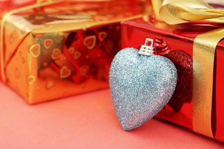 Several colored gift boxes and decorative heart photo