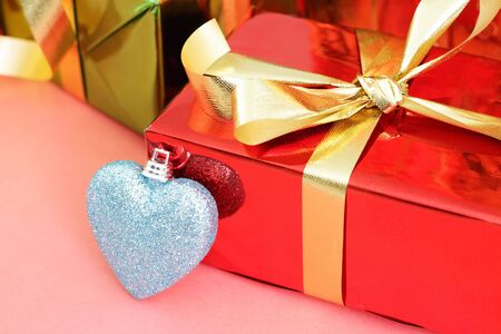 Several multi-colored gift boxes and decorative heart photo