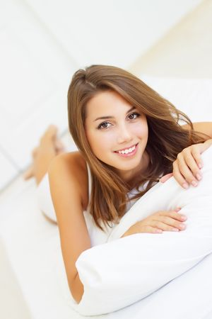 smiling girl lying on the bed Stock Photo - 7907991
