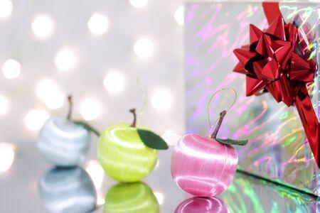 Three red Christmas ball and gift box photo