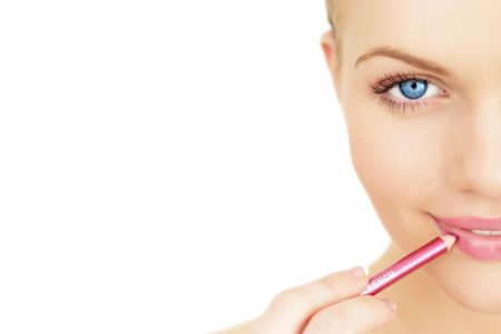 concealer: Applying lipstick using lip concealer brush isolated on a white background Stock Photo