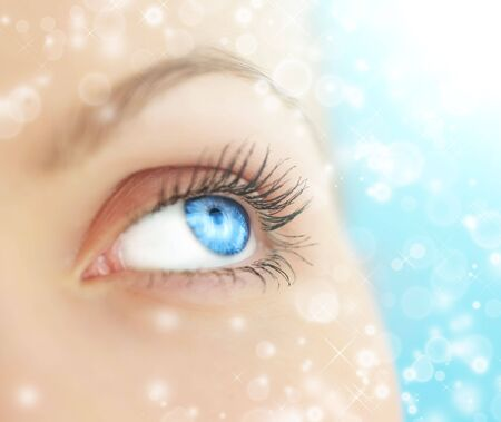 close eye: Human eye on blue background Stock Photo