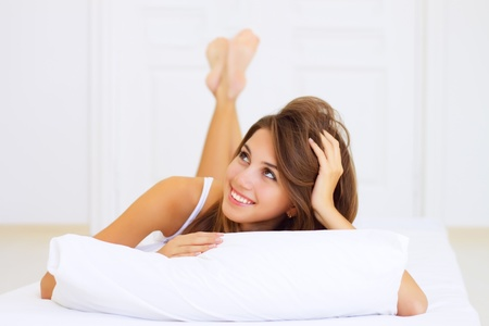 smiling girl lying on the bed Stock Photo - 8285997