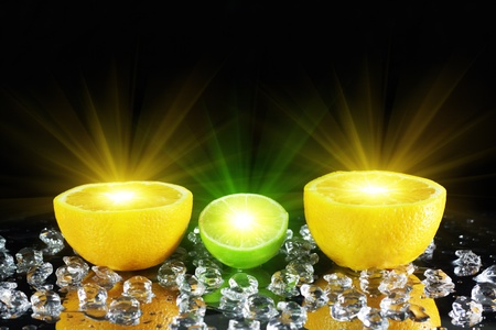 Two orange and lime on a black background Stock Photo - 8286006