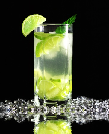 Mojito cocktail with fresh limes on a black background Stock Photo
