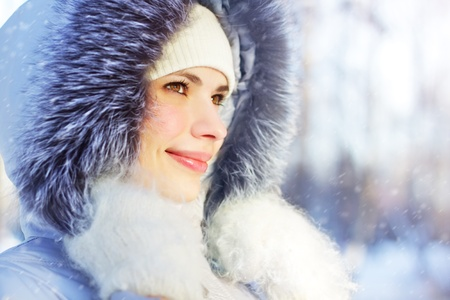 Portrait of girl in hooded jacket. Winter nature Stock Photo