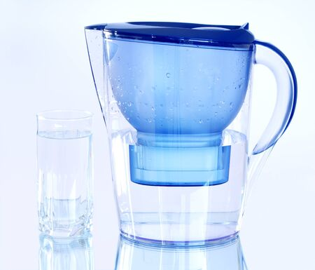 mirror on the water: Water filter on a light blue background Stock Photo
