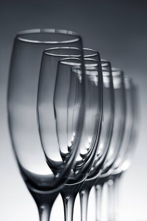several: Empty champagne glasses on gray background