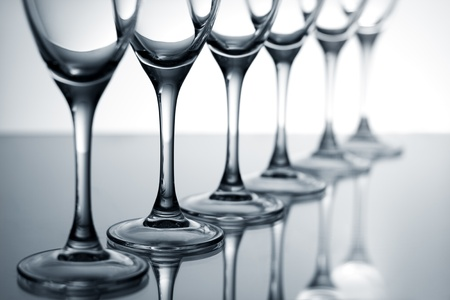 Empty champagne glasses on gray surface of the mirror photo
