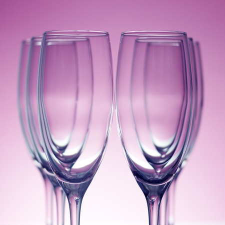 Empty champagne glasses on purple background Stock Photo - 8534609