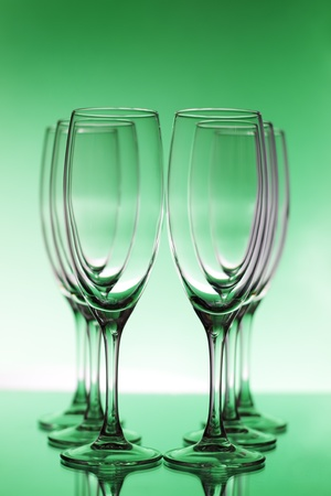 Empty champagne glasses on a green background Stock Photo - 8534660